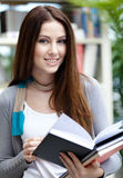 Female student opens book Stock Photography