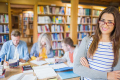 Female student with others in background at library Stock Photography