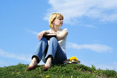 Female student outdoor on gren grass with books Royalty Free Stock Photos