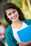 Female student outdoors Stock Photo
