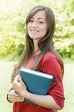 Female student outdoors Royalty Free Stock Image