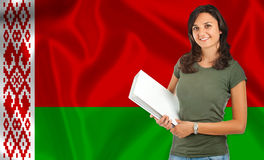 Female student over Belarusian flag Stock Image
