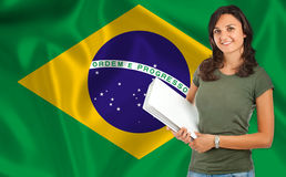 Female student over brazilian flag Royalty Free Stock Photography