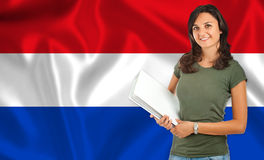 Female student over Dutch flag Royalty Free Stock Photo