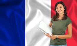 Female student over French flag Royalty Free Stock Images