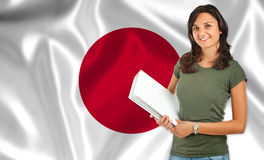 Female student over Japanese flag Stock Photo