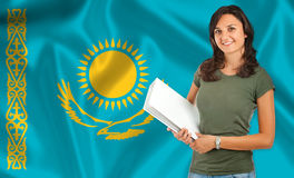 Female student over Kazakh flag Stock Photo