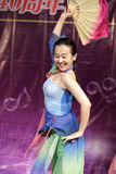 The female student perform folding fan dance Stock Photography