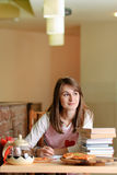 Female Student in pizzeria Stock Image