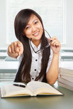 Female student pointing at camera Stock Photos