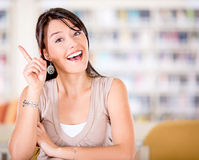 Female student pointing an idea Stock Image