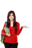 Female student pointing up Royalty Free Stock Photos