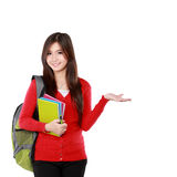 Female student pointing up Royalty Free Stock Photography