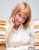 Female Student Portrait. Close-up of a girl working in a library Stock Images
