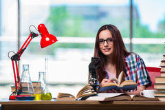 The female student preparing for chemistry exams Stock Images