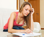 Female student is preparing for exam at home Royalty Free Stock Image
