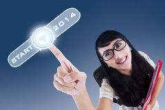 Female student pushing a button Royalty Free Stock Photos