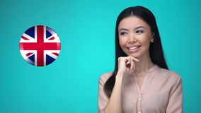 Female student pushing Great Britain flag button, ready to learn language. Stock footage stock footage