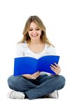 Female student reading Royalty Free Stock Photos