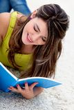 Female student reading Royalty Free Stock Image