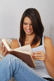 Female student reading a book Royalty Free Stock Image