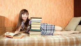 Female student reading book Royalty Free Stock Photo