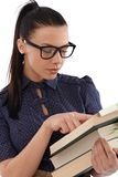 Female student reading book. Following by finger Royalty Free Stock Images