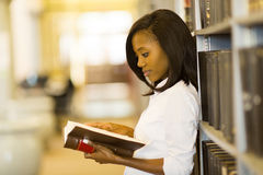 Female student reading book Royalty Free Stock Image