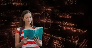 Female student reading book black background with equations. Digital composite of Female student reading book black background with equations Stock Image