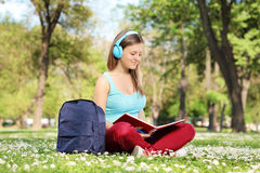 Female student reading a book in park Royalty Free Stock Photos