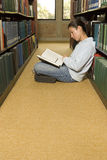 Female student reading in the library Stock Image