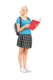 Female student reading from a notebook Stock Photography