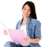 Female student reading a notebook Royalty Free Stock Photos
