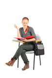 Female student reading on school desk Stock Image
