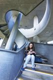 Female Student Reading On Staircase Stock Photography