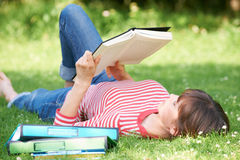 Female Student Reading Textbook In Park Royalty Free Stock Images