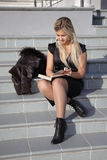 Female student reads the book Stock Photo