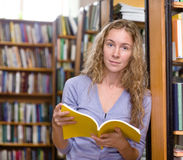 Female student reads the book Stock Images