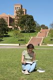 Female student reads for the class Stock Photo
