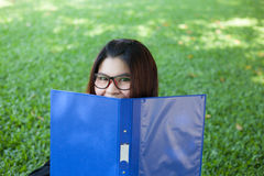 Female student remove the face cover Stock Photo