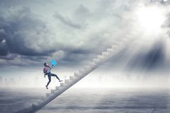 Female student running on the stairs Royalty Free Stock Images