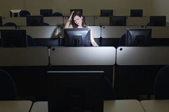 Female Student Scratching Head While Looking At Computer Royalty Free Stock Photo