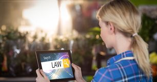 Female student searching for law studies on tablet PC Stock Photo