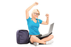 Female student seated working on a laptop Stock Images