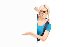 Female student showing at a blank banner Stock Images