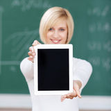 Female Student Showing Digital Tablet In Classroom Stock Photography