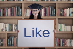 Female student showing like sign Royalty Free Stock Images
