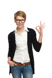 Female student showing OK sign. Stock Image