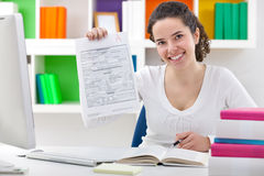 Female student showing perfect grade A plus. Royalty Free Stock Photography