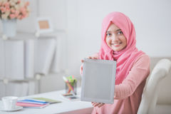 Female student showing tablet screen and smile to camera Royalty Free Stock Photo